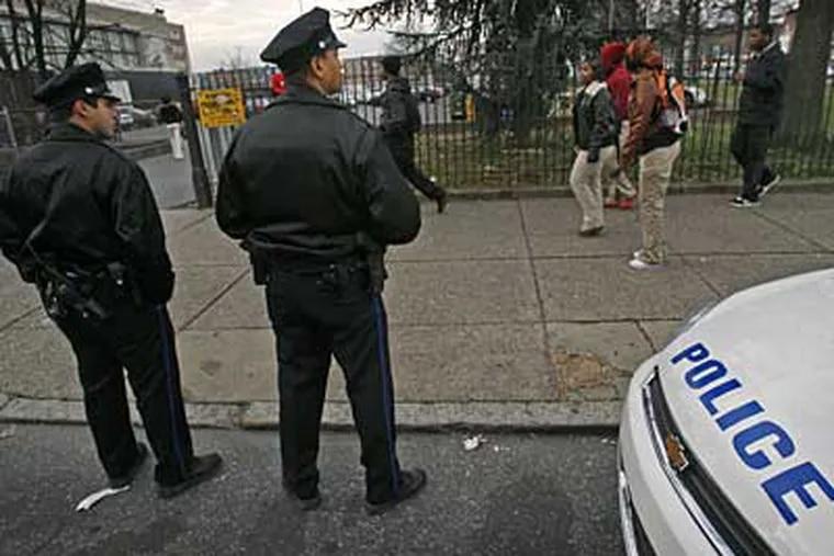 Philadelphia police keep watch at South Philadelphia High School. Increasing violence has led Asian students to boycott the school. (ALEJANDRO A. ALVAREZ / Staff Photographer)