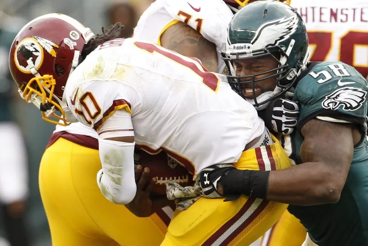 The Eagles' Trent Cole sacks Redskins quarterback Robert Griffin III in a game back on Nov. 17, 2013 at Lincoln Financial Field.