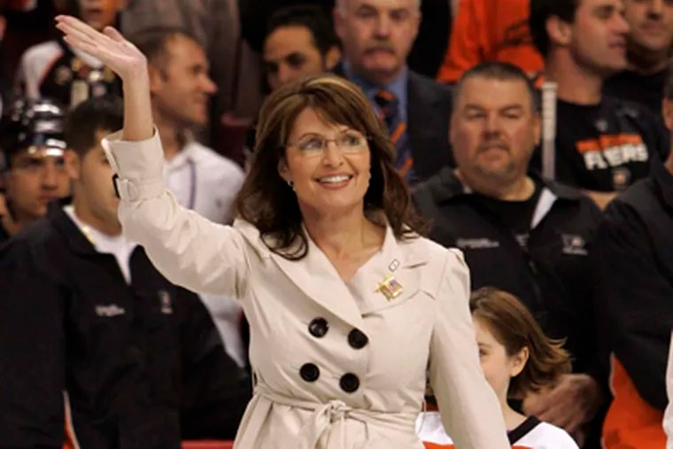 In 2008, then-Republican Vice Presidential candidate Sarah Palin waves to the cheering crowd in the Wachovia Center as she walks on to the ice to drop the first puck of the Flyers season in their game against the New York Rangers. (Laurence Kesterson / Staff Photographer)