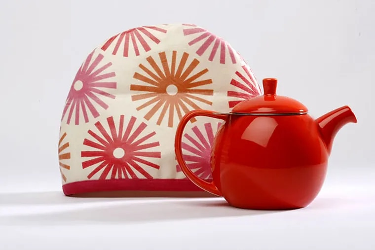 Hunker down with hot tea and keep your pot warm with this charming cozy, handmade by Cozy Toes in East Falls. Cozies come in two sizes and five designs. They are laminated on the outside, batted and lined with knit fabric inside. Curve 24-ounce teapot with infuser by ForLifeDesign.com in nine colors, dish washer and microwave safe.