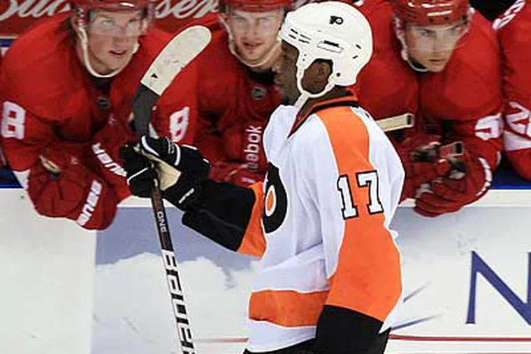 A fan threw a banana at Wayne Simmonds during his shootout attempt against the Red Wings. (Dave Chidley/AP)