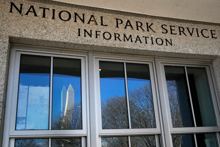 The Washington Monument is reflected in a window of a closed information station serving the World War II Memorial, Wednesday, Dec. 26, 2018, in Washington. A shutdown affecting parts of the federal government appeared no closer to resolution Wednesday, with President Donald Trump and congressional Democrats locked in a hardening standoff over border wall funding that threatens to carry over into January. (AP Photo/Jacquelyn Martin)