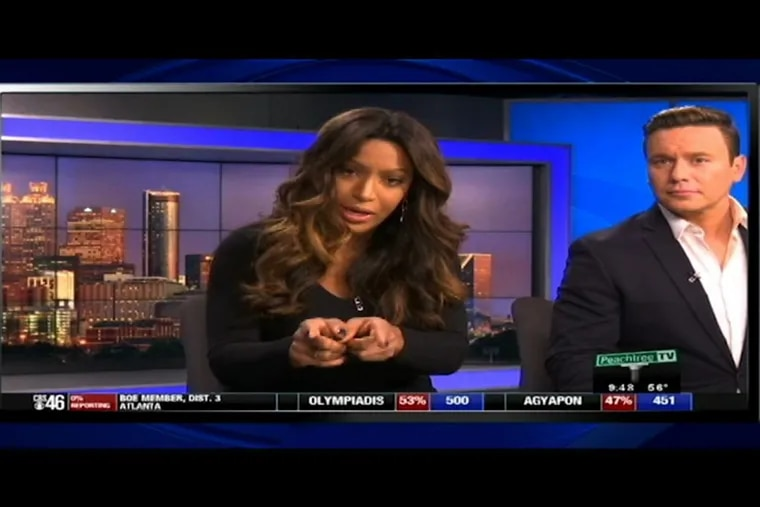 """In this frame made from video, an Atlanta news anchor responds on Tue., Dec. 5, 2017, to a viewer who called her a racial slur in an email. Sharon Reed, an anchor for WGCL-TV, read the email on air Tuesday night and posted it on Facebook. The viewer says Reed should be fired for a """"race baiting comment"""" and says: """"It's o.k. for blacks to discuss certain subjects but not whites, really???"""" The viewer then calls Reed the N-word."""