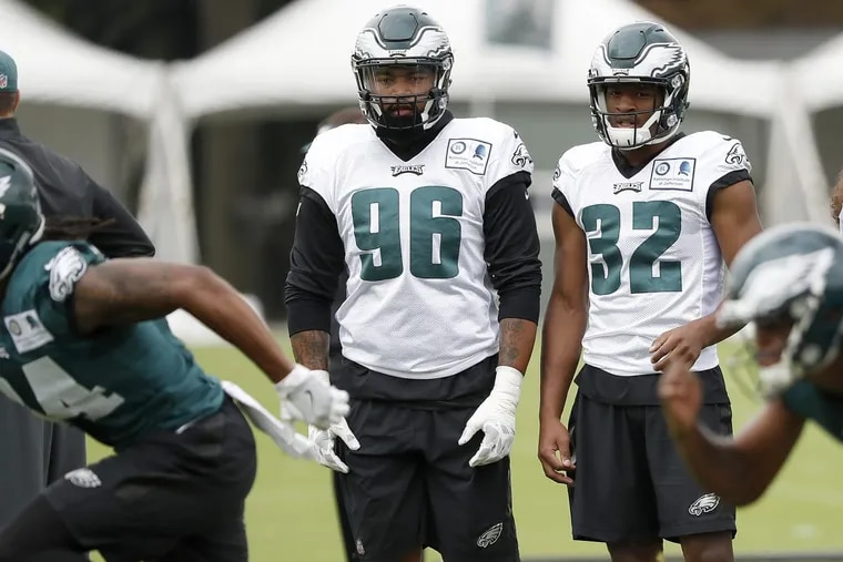 Eagles' rookies Derek Barnett, left, and Rasul Douglas, right, watch during the Eagles 2017 training camp at the NovaCare complex in Philadelphia, PA on July 26, 2017. DAVID MAIALETTI / Staff Photographer