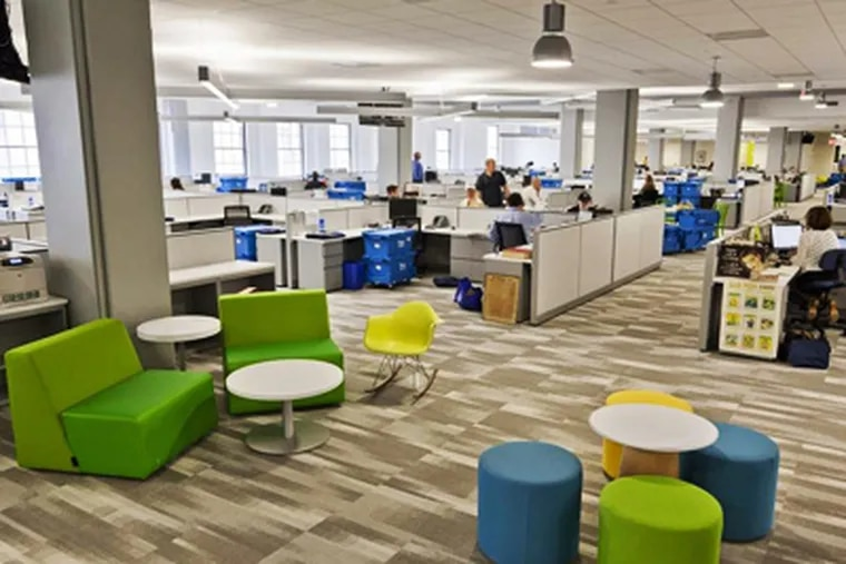 The new Inquirer newsroom, located at 801 Market street, replacing the old tenant Strawbridges and Clothier, July 9 2012. (ELISE WRABETZ / Staff Photographer)