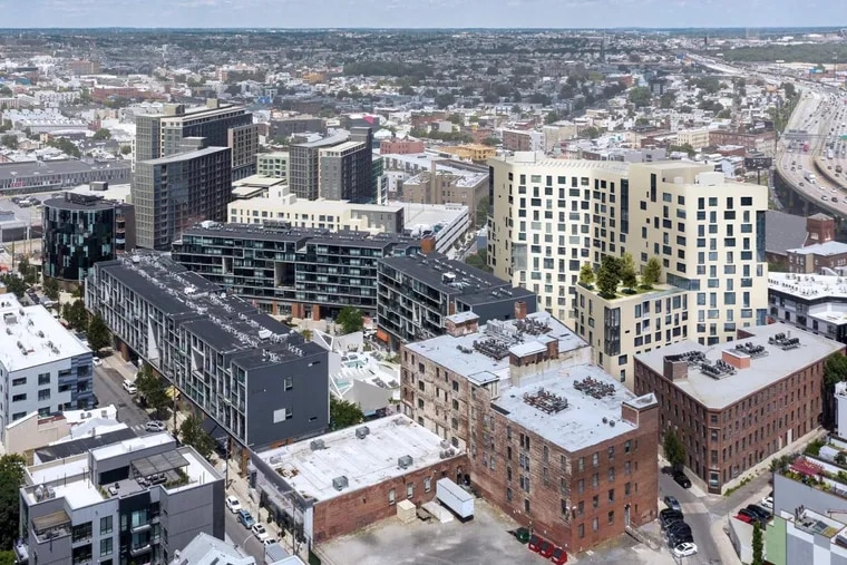 This rendering shows the Post Brothers' vision for the central area around the Piazza complex. The taller buildings in the upper left are under construction, and plans for the cream-colored tower on the right will be presented to the Design Review Board later this year.