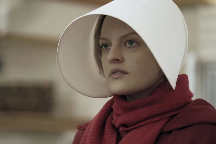 """Elisabeth Moss as Offred in a scene from Hulu's """"The Handmaid's Tale,"""" an adaptation of Margaret Atwood's 1985 novel"""