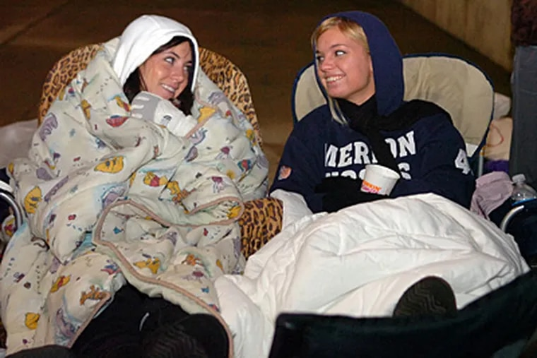 Katie Quinn (left), 19, and friend Melinda Affrol, 20, camped out all night with hundreds to meet 'Twilight' star Robert Pattinson at the King of Prussia Mall. (Sarah J. Glover / Staff Photographer)