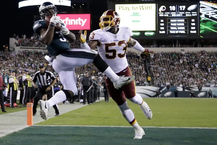 Eagles running back Corey Clement (left) makes a touchdown catch on a pass as Washington Redskins inside linebacker Zach Brown defends during the Eagles' win on Oct. 23.