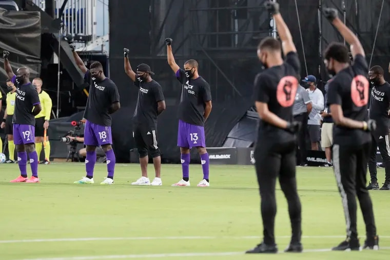 Orlando City players joined players from other teams across MLS to raise their fists in the air in solidarity before the kickoff of MLS' tournament opener in Orlando.
