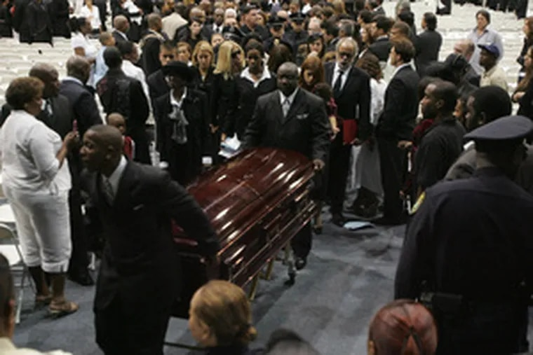 Sean Taylor's casket is removed after the funeral service for the 24-year-old on the campus of Florida International University.