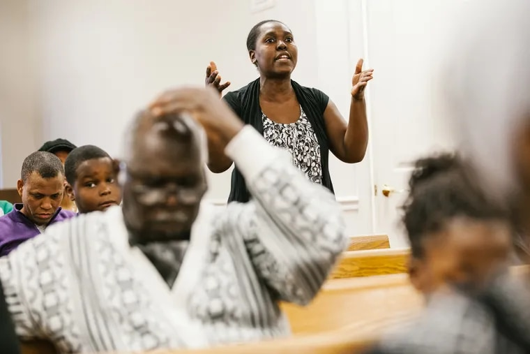Geolle Vincent expresses concern to immigration lawyers at Premiere Eglise de Dieu de la Prophetie Hatienne in Germantown last year, as the Trump administation weighed whether to end TPS for Haitian people in the United States.