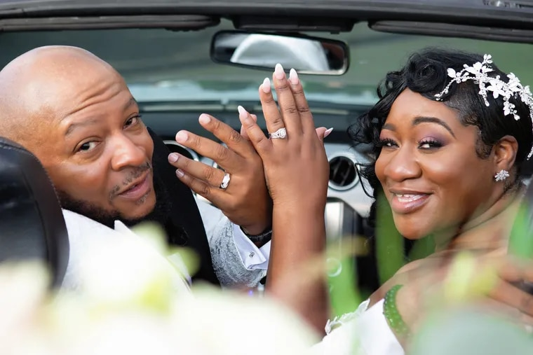 Newlyweds Shani Felder And Walter Hawkins Jr. in the convertible Walter rented for the occassion. Shani also splurged on a convertible - her custom made wedding dress, which featured a removable train and sleeves.