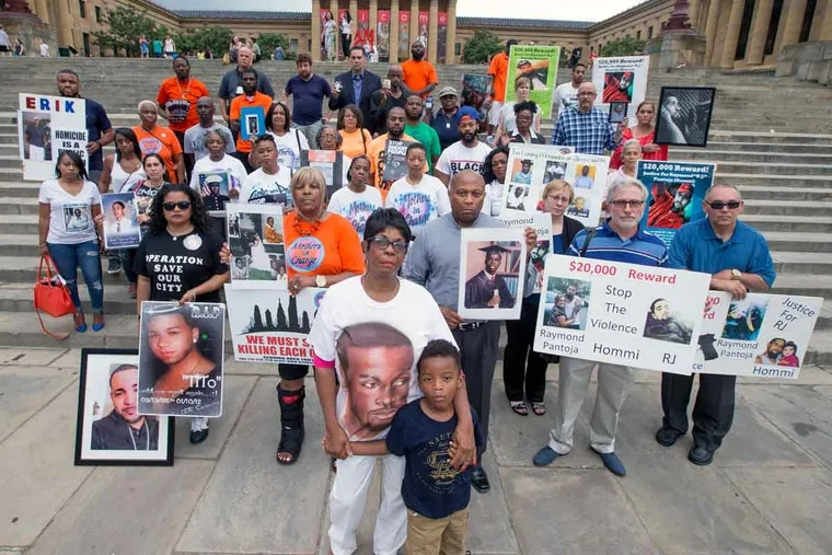 Folks impacted by gun violence gather at the Art Museum steps.