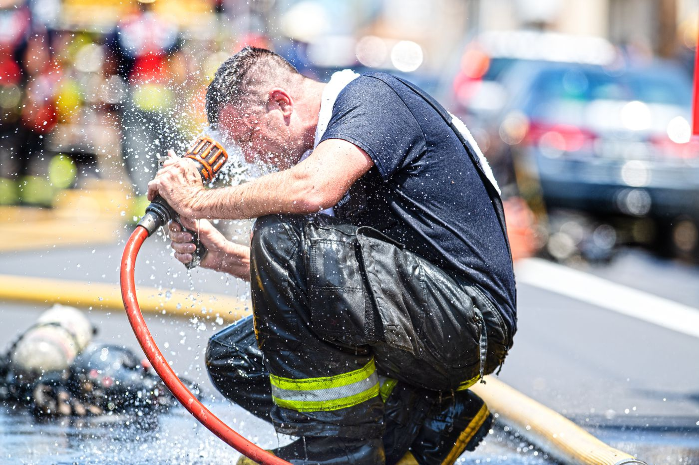 Firefighter cools off after a long day in the sun