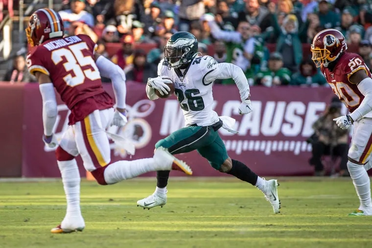 Miles Sanders runs for a first down during the third quarter of the Eagles' win over the Redskins.
