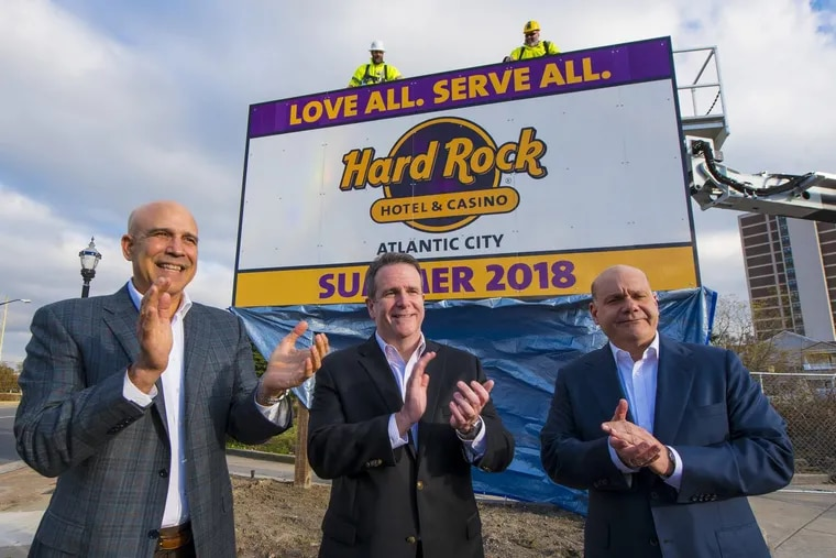 The first sign for the new Hard Rock Hotel & Casino is unveiled by partners Joe Jingoli, Jr. (left) and Jack Morris (right) along with Matt Harkness, the local president of this Hard Rock property. The sign is at the corner of Absecon Blvd. and Virginia Ave.