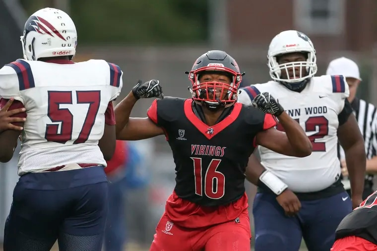 Northeast High senior Elijah Jeudy (No. 16), shown here after a sack in a game vs. Penn Wood in September 2019, is a University of Georgia recruit and one of the top players in the city.