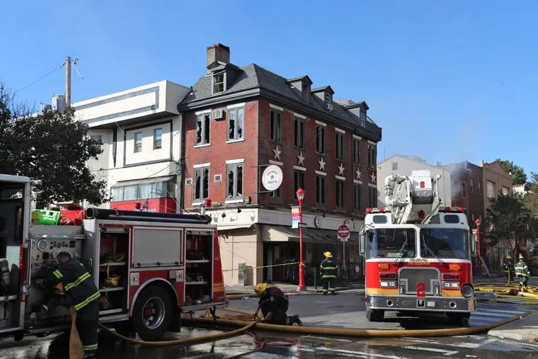 Firefighters remain after the blaze was extinguished at  Bridget Foy's on South Street on Oct. 25.