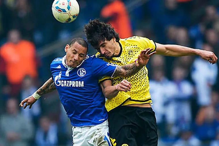Schalke 04's roster includes rising star U.S. national team midfielder Jermaine Jones (left). (Martin Meissner/AP file photo)