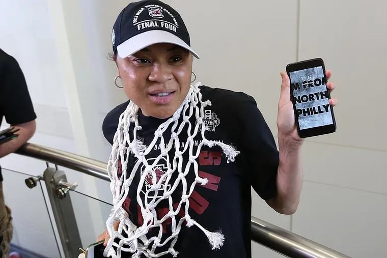 """Dawn Staley holds up her phone showing off her lock screen, which says """"I am from North Philly."""" Dawn Staley and A'ja Wilson spoke to the media after returning from Dallas Texas, where the South Carolina women's basketball team won the 2017 National Championship."""