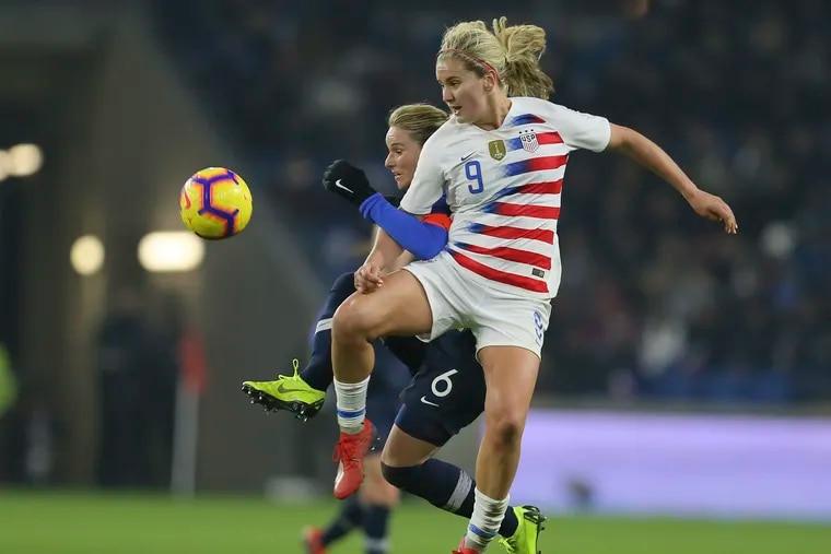 Lindsey Horan vies for the ball with France midfielder Amandine Henry during a women's international friendly between France and United States in January.