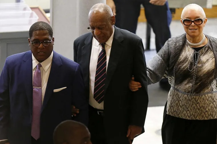 Bill Cosby (center) and his wife, Camille Cosby, enter the Montgomery County Courthouse in Norristown with Cosby spokesman Andrew Wyatt on Monday June 12, 2017.