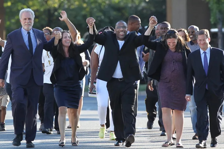 Anthony Wright Sr. , center, walks out of Curran Fromhold Correctional Facility holding his hands up in triumph with his lawyers, left to right, Peter Neufeld, Nina Morrison, Rebecca Lacher and Sam Silver. A Philadelphia jury in August 2016  found Anthony Wright not guilty of the crimes. He was released from Curran Fromhold Prison on Tuesday August 23rd, 2016 where his lawyer and family welcomed him back to his freedom. 08/23/2016 MICHAEL BRYANT / Staff Photographer