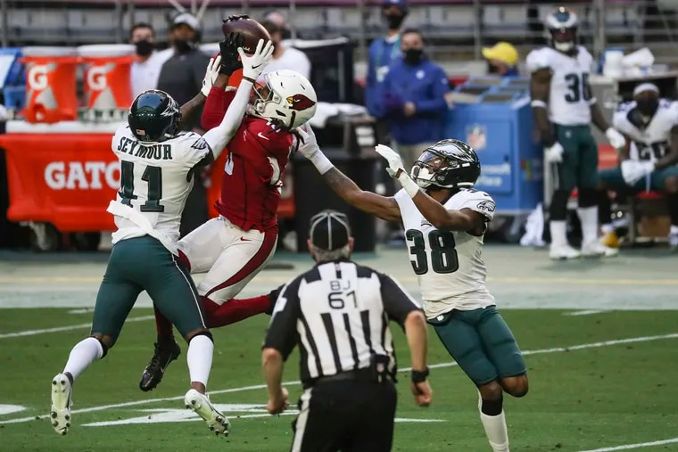Arizona Cardinals WR DeAndre Hopkins makes the catch over the Eagles' Kevon Seymour and Michael Jacquet in the second quarter of Sunday's 33-26 loss.