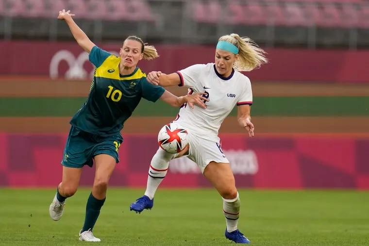 Julie Ertz (right) and Australia's Emily Van Egmond battle for the ball during the first half.