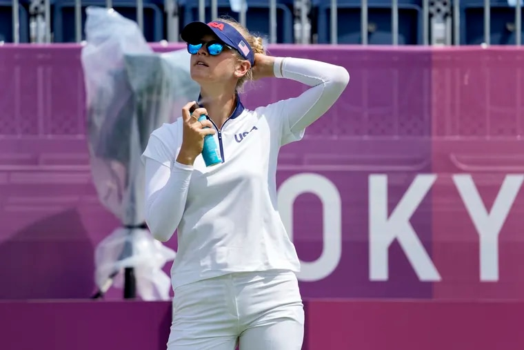 Nelly Korda, of the United States, applies sunscreen during a practice round prior to the women's golf event at the 2020 Summer Olympics, Monday, Aug. 2, 2021, at the Kasumigaseki Country Club in Kawagoe, Japan, (AP Photo/Andy Wong)