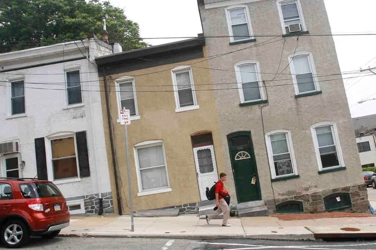 """Houses on Levering Street appear to be sinking when the camera angle matches the start of the steep incline known as """"The Wall."""" Riders scale The Wall 10 times."""