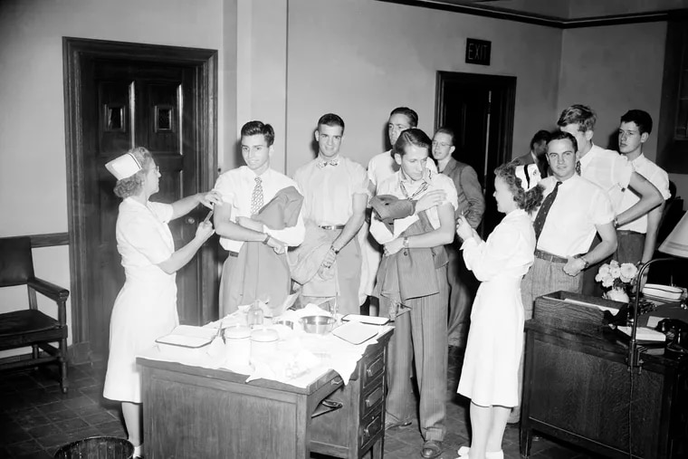 Yale University students gladly line up in New Haven, Conn., on Sept. 25, 1946, for inoculation with a new serum developed by the Army against influenza. Getting the shots, which were prescribed for all faculty members, students, and employees after experts predicted an epidemic year for Type A influenza, was seen by most as their patriotic duty.