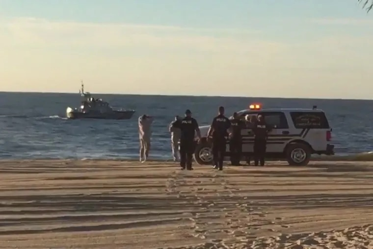 Rescuers search for a missing swimmer off Atlantic City who was later found dead.