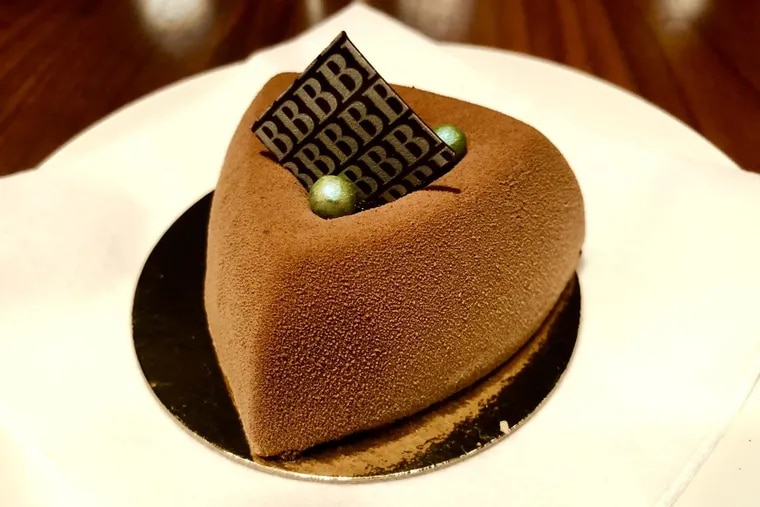 The Thai basil flourless chocolate cake from Bistro Barberet in Lancaster is sprayed with a velvety chocolate texture and stuffed with dark chocolate mousse and a heart of Thai basil and tart cranberries.