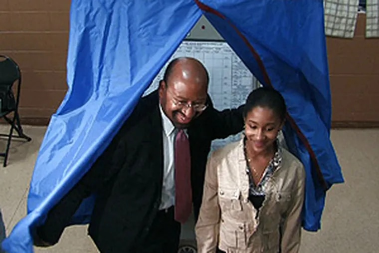 Democratic mayoral candidate Michael Nutter emerging from the voting booth this morning.