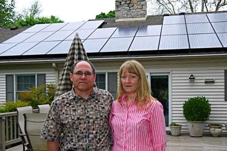 Mari and Arthur Jensen have fought a 19-month battle at the Public Utility Commission with Peco Energy Co. over the method by which the utility pays customers with solar panels for the power they sell back to the grid. In the end, the PUC agreed with the Jensens and forced Peco to compensate 540 customers for not paying them enough for the power they generated. Mari Jensen said they fought the issue on principal, not for the money. The Jensen's take: $1.42. ( Andrew Maykuth / Staff Photographer )