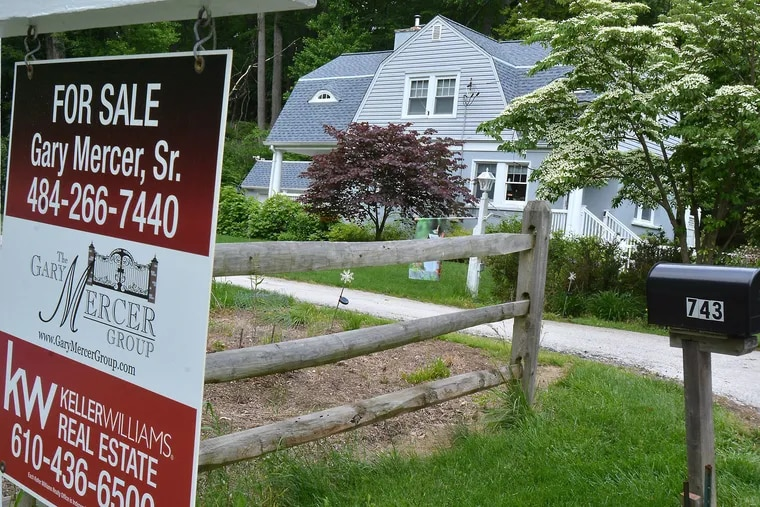 A home in Malvern, with a for-sale sign in 2017. Real estate agents today are adjusting how they help clients sell and buy homes because of restrictions caused by the coronavirus pandemic.