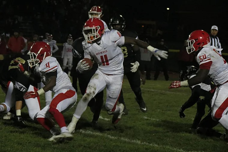 Rancocas Valley's Iverson Clement rushes for a big gain in the Red Devils 35-12 win over Burlington Township.