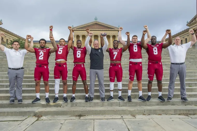 OWLSFB03-f.Single digit members of the Temple University Football Team and their coaches pose for a photograph on the steps of The Philadelphia Museum of Art on August 2, 2018. From left are David Feely, Head Strength and Conditioning Coach, Delvon Randall, 2 Shaun Bradley, 5, Rock Ya-Sin, 6, Geoff Collins, Head Football Coach, Ryquell Armstead, 7, Frank Nutile, 8, Michael Dogbe, 9 and Ryan Horton Assistant Strength and Conditioning Coach. (Jonathan Wilson / For the Inquirer)