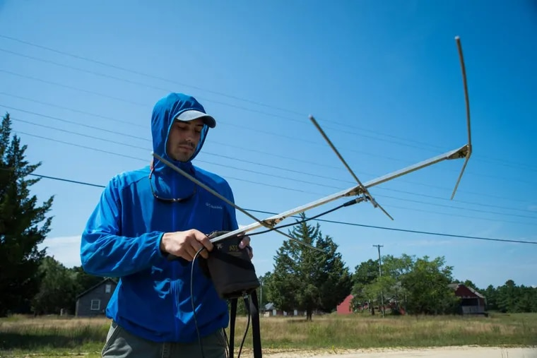Phil Coppola, a doctoral student from the University of Delaware,  uses a telemeter to search for quail at the Pine Island Cranberry Co. in Burlington County.