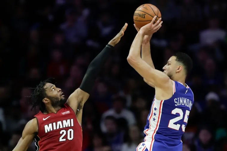 Ben Simmons, shown shooting over Heat forward Justise Winslow in February, has impressed coach Brett Brown with his offseason work on his outside shooting.