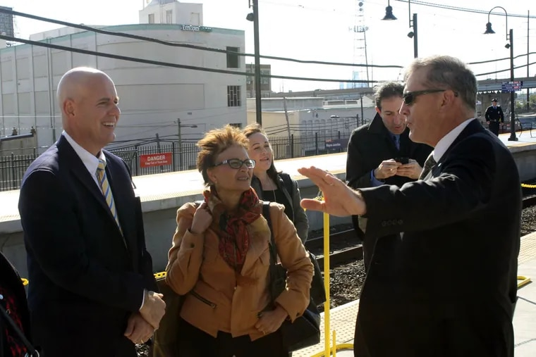 SEPTA general manager Jeff Knueppel (left), FTA acting Administrator Therese McMillan, and Robert Lund, SEPTA assistant general manager, discuss the rail project at the station unveiling.