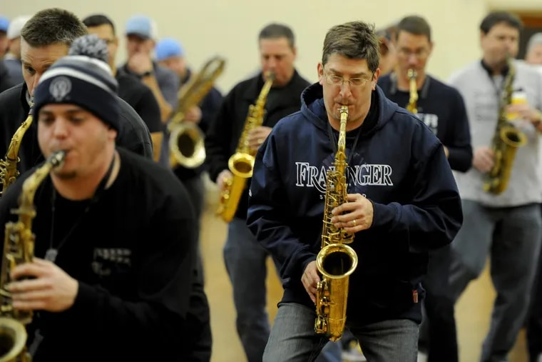 As 2018 arrives, John McDevitt (right), is  looking forward to making a comeback with the Fralinger String Band. He and other band members rehearse at Holy Ghost Byzantine Catholic Church in South Philadelphia December 28, 2017. McDevitt joined the Mummers when he was in elementary school and for nearly three decades, he has been a regular in the New Year's Day parade. But in 2017 he was sidelined by brain surgery.