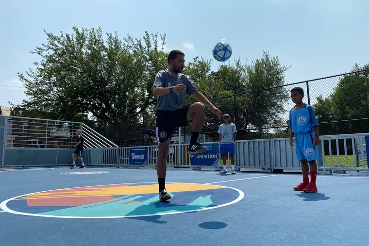 People play soccer on the newly unveiled mini soccer pitch at Francis J. Myers Recreation Center in Southwest Philadelphia. This is the first of 15 mini pitches, plus two full-size fields, coming to Philadelphia over the next five years.
