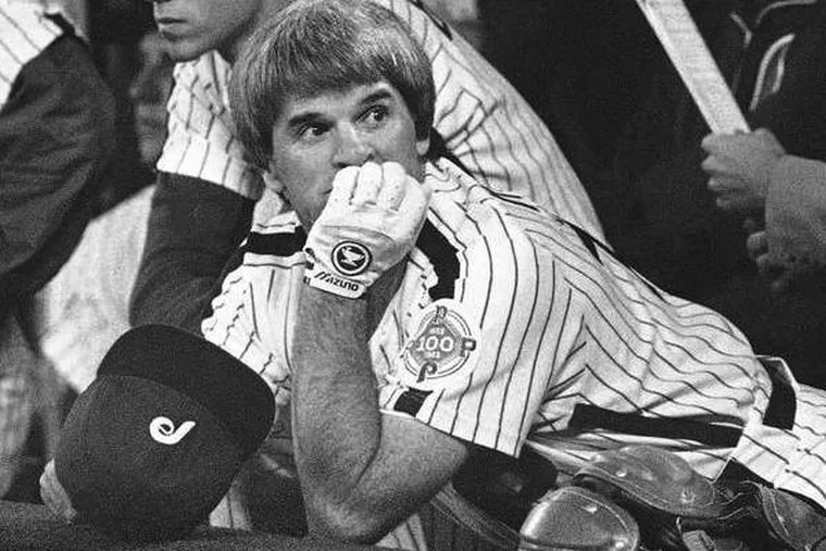 Pete Rose, benched for Game 3 of the 1983 World Series, is perched on the top step of the dugout. (Associated Press)