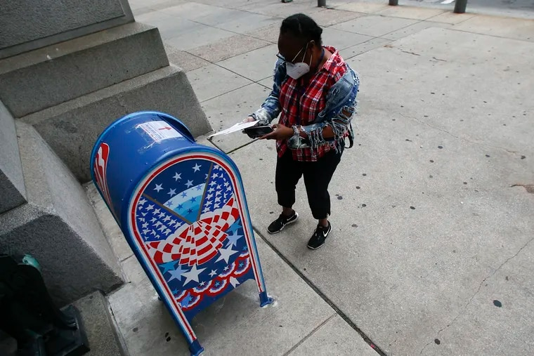 A voter prepares to drop off a ballot at a drop box outside Philadelphia City Hall on May 28.