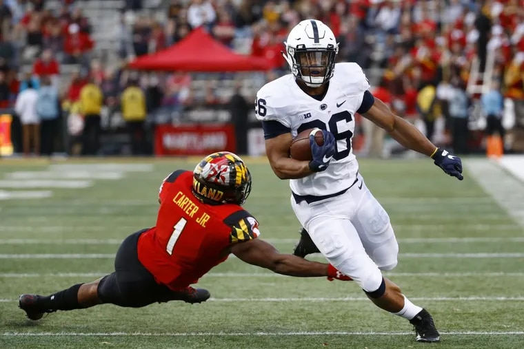 Penn State running back Saquon Barkley, right, rushes past Maryland linebacker Jermaine Carter Jr. in the first half of an NCAA college football game in College Park, Md., Saturday.