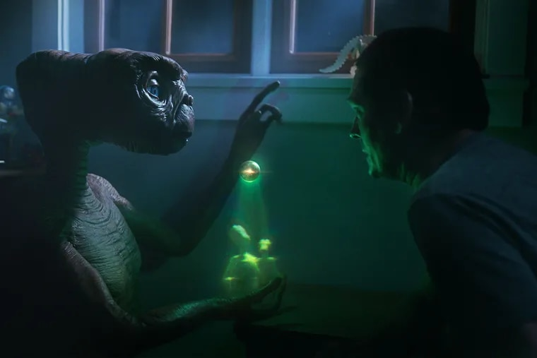A still image from Comcast's new commercial featuring E.T. and Henry Thomas, the actor who played Elliott in the 1982 blockbuster.