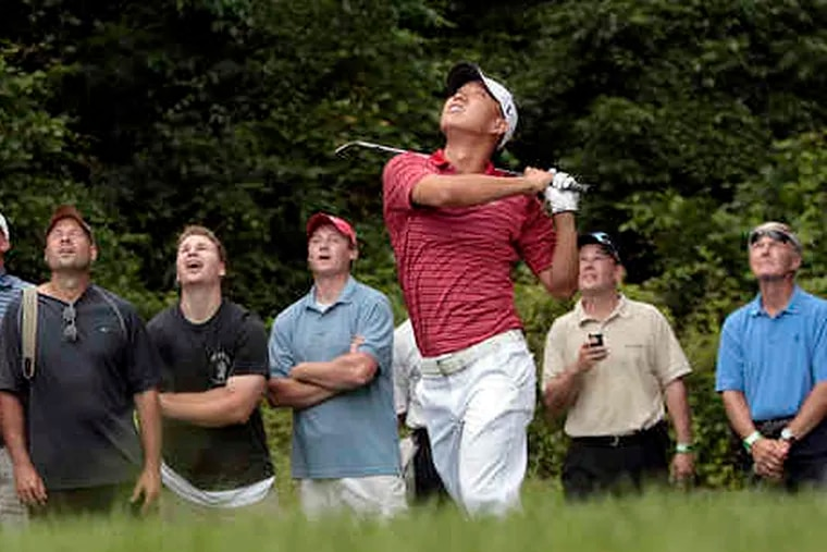 Anthony Kim makes a high chip onto the green in the Exelon Invitational at the ACE Club in Lafayette Hill. He and Jim Furyk defeated Paul Casey and Kenny Perry.